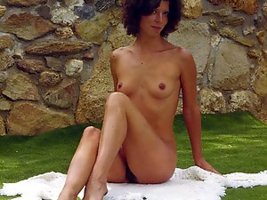 Pretty-looking older mom posing undressed