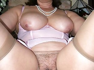 Randy old slut is masturbating herself