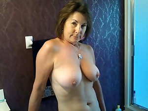 Voluptuous older cutie getting pleasured on camera