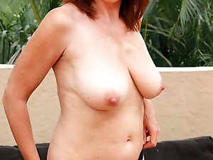 Mature mistress getting undressed on cam